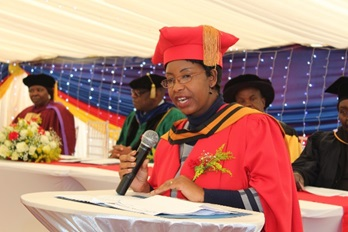Professor A. Chitando (Dean – Faculty of Arts and Education), The Guest of Honour presenting her speech to graduands and other guests.